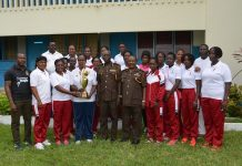 Holding the trophy is Supt. Evelyn Ghartey, on her immediate left is Ag. DGP PD Missah. Picture: Sgt. Frank Tutu.