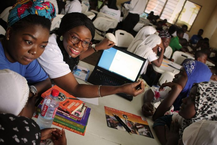 Volunteers train students on using digital literacy tools