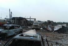 Wreckage of cars are seen at the explosion site of a gas station in north Accra, capital of Ghana, Oct. 8, 2017. The number of people killed in the Saturday night gas explosion at a fuel station in Ghana's capital city Accra has gone up to six, with 35 injured, deputy spokesman of the Ghana National Fire Service (GNFS) Prince Billy Anaglate told Xinhua on Sunday. (Xinhua/Justice Adoboe) (yk)