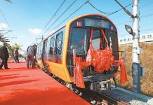 Subway cars tailored for use on Boston's orange line roll off the production line in Changchun, capital of northeast China's Jilin Province, Oct. 16, 2017. (Photo by People's Daily Online)
