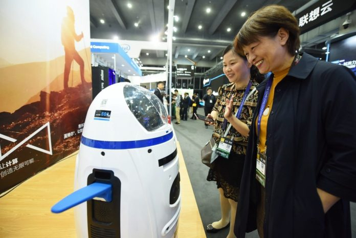 Visitors interact with intelligent robots during
