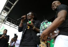 Shatta Wale distributing Storm Energy Drink to fans