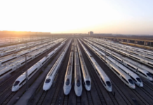 Bullet trains in Shanghai Hongqiao Train Station, China's largest railway station, ready to set off. (Photo by Pan Xiaofan from People's Daily)