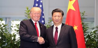 Chinese President Xi Jinping (R) meets with his US counterpart Donald Trump on the sidelines of a Group of 20 (G20) summit, in Hamburg, Germany, July 8, 2017. The two heads of state exchanged in-depth views on bilateral ties and global hot-spot issues. (Xinhua/Yao Dawei)