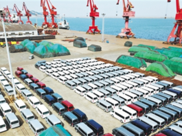 China-produced passenger vehicles are waiting to be shipped at the port of Lianyungang, eastern China's Jiangsu province on March 5, 2018. The port handled a cargo capacity of nearly 40 million tons in the first two months of 2018, up 4 percent year on year. (Photo by Economic Daily)