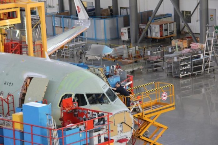 Airbus' Tianjin center delivered the 8,000th A320 family aircraft to Air China. (Photo by Li Yingqi from People's Daily)