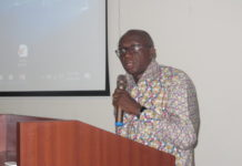 Mr Ambrose Dery addressing the meeting