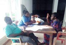 Ms. Mary Mensah sharing her experience with Staff of AITI-KACE (Mr Edward Yeboah and Mrs Lucy Dzoagbe