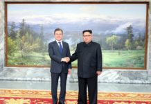 South Korean President Moon Jae-in (L) and top leader of the Democratic People's Republic of Korea (DPRK) Kim Jong Un hold their second summit at the DPRK side of the border village of Panmunjom, on May 26, 2018. (Xinhua/Blue House)