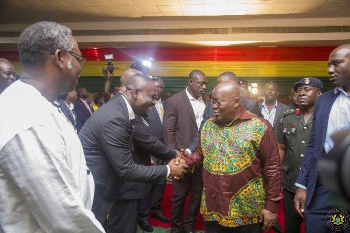 President Akufo Addo with the CEO of NEIP John Kumah