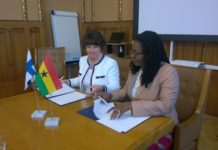 Mrs Ursula Owusu-Ekuful (right) and Anne Berner signing the MoU