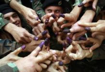 Iraqi policemen show their ink-stained fingers after casting their vote at a polling station in Baghdad on March 4, 2010. More than 800,000 Iraqis including security personnel, doctors, prisoners and hospital workers voted prior to the general national election Sunday, March 7th. UPI photos/Ali Jasim