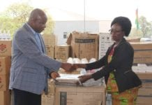 Photos of Professor Teye presenting the items to beneficiaries