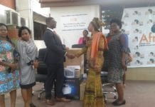 Mr Niyi Ojoulape, the UNFPA Country Representative presenting the items to Dr Afisah Zakariah, the Chief Director of the Ministry of Gender, Children and Social Protection.