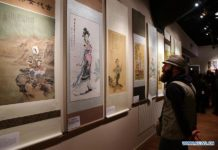 People visit an exhibition in Cairo, Egypt, on Feb. 16, 2019. Paintings of famous Chinese female painter Qin Bailan ornamented an international exhibition in the Egyptian capital Cairo. The exhibition was part of the third edition of Awladna International Forum for Arts of the Gifted. Qin, whose paintings are about traditional figures, said that she has been promoting for the Chinese culture through her paintings for 40 years. Despite her disability, Qin did not allow it to define her. She has made a name for herself as one of China's best artists. (Xinhua/Ahmed Gomaa)