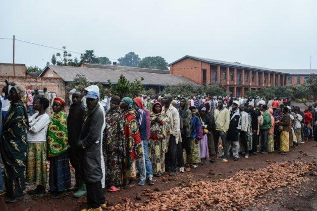 Hundreds of Burundians lined up for the vote in which they are merely asked to decide yes or no. AFP/STR