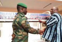 The UW Regional Minister, Alhaji Sulemana Alhassan presented one of the beds with mattress to the Commander of the Military Detachment, Lieutenant Ralph B