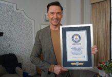 hugh jack man with certificate