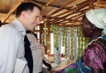 Justin Derbyshire, CEO, HelpAge International (left) chats with unidentified South Sudanese Older Woman trader at the Gambella Refugee camp in Ethiopia