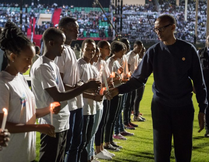 A young Rwandan lights the candle for Rwandan President Paul Kagame at a night vigil to commemorate the 25th anniversary of the 1994 Rwandan genocide against Tutsi, in Kigali, capital of Rwanda, on April 7, 2019. Rwandans on Sunday started the commemoration to mark the 25th anniversary of the 1994 genocide that left over 1 million people dead, mainly ethnic Tutsis, with President Pual Kagame calling for continued efforts to transform the country. (Xinhua/Office of the President of Rwanda)
