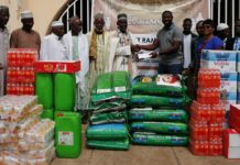 Some-independent-representatives-of-QNET-handing-over-the-donated-items-and-cash-to-the-Chief-Imam-of-Tamale