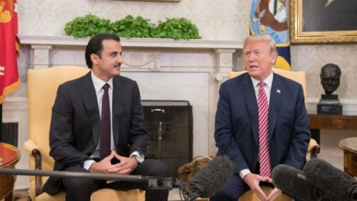 Emir of the State of Qatar, His Highness, Sheikh Tamim bin Hamad al Thani and U.S. President Donald Trump at inside the Oval Office.