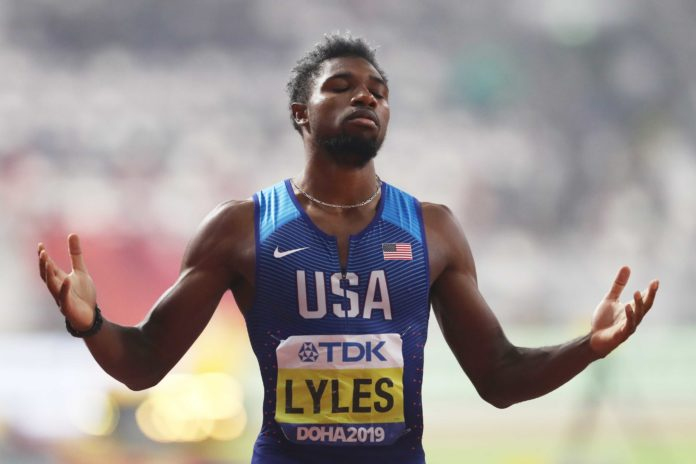 Noah Lyles of the United States celebrates winning the Men's 200 Metres final during day five of 17th IAAF World Athletics Championships Doha 2019 on October 01, 2019 in Doha, Qatar. (Photo by Alexander Hassenstein/Getty Images)