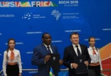 Left-Claver Gatet, Rwanda Minister of Infrastructure. Right-Alexy Likacheve, Director General of Rosatrom. Speaking at the Russia-Africa Summit in Sochi.