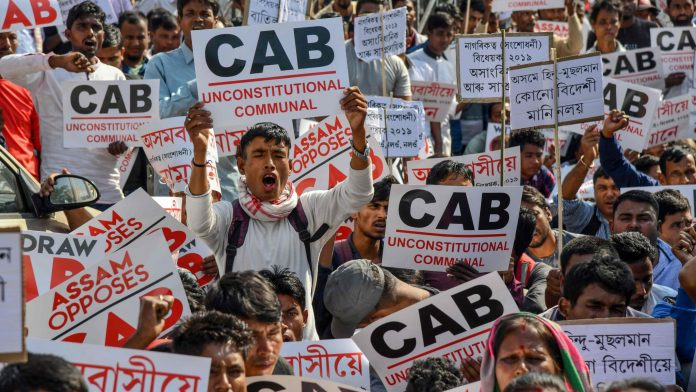 Activists of Krishak Mukti Sangram Samiti (KMSS) shout slogans during a protest against the government's Citizenship Amendment Bill proposal to provide citizenship or stay rights to minority communities from Bangladesh, Pakistan and Afghanistan in India, in Guwahati on November 22, 2019. (Photo by Biju BORO / AFP) (Photo by BIJU BORO/AFP via Getty Images)