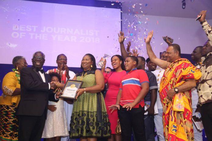 The Senior Minister, Yaw Osafo-Marfo, presenting the GJA Journalist of the Year Award to Doreen Hammond