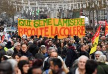 "People hold a banner reading ""who sows misery reap the rage"" as they take part in a demonstration to protest against the pension overhauls, in Marseille, southern France, on December 5, 2019 as part of a national general strike. - Trains cancelled, schools closed: France scrambled to make contingency plans on for a huge strike against pension overhauls that poses one of the biggest challenges yet to French President's sweeping reform drive. (Photo by CLEMENT MAHOUDEAU / AFP)"