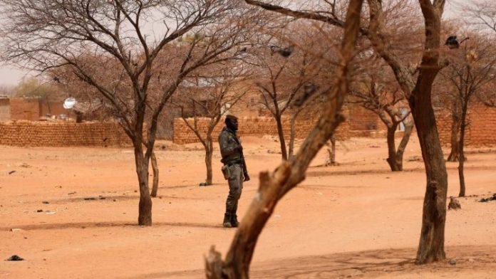 Burkina Faso soldier stands guard at the village of Gorgadji in the Sahel region