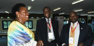 Hon. Mutuuzo Peace Regis, Minister of State for Gender and Cultural Affairs Uganda (left) is welcomed by Mr Necodimus Chipfupa, Regional Director, HelpAge International (centre) as Mr Joram Tiibasimwa, Chairman, National Council for Older Persons in Uganda looks on.