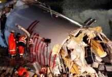 First responders look inside the Pegasus Airlines Boeing 737-86J plane, after it overran the runway during landing and crashed, at Istanbul's Sabiha Gokcen airport, Turkey February 5, 2020 (photo credit: REUTERS/MURAD SEZER)