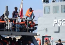 Rescued migrants wait for disembarkation on the deck of the Armed Forces of Malta's patrol boat P24 in Floriana, Malta, on Aug. 26, 2019. The Armed Forces of Malta brought in 73 migrants who were rescued off a rubber dinghy in the Maltese search and rescue region on Monday afternoon. (Photo by Jonathan Borg/Xinhua)
