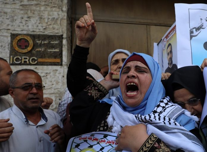 Palestinians take part in a protest against the death of Palestinian prisoner Bassam al-Sayeh in Gaza City, Sept. 9, 2019. Bassam al-Sayeh from the northern West Bank city of Nablus, who suffered cancer, died in an Israeli prison. The Palestinians slammed Israel for medical negligence. (Photo by Yasser Qudih/Xinhua)