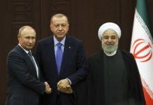 Turkish President Recep Tayyip Erdogan (C), Russian President Vladimir Putin (L) and Iranian President Hassan Rouhani pose for a group photo after their summit in Ankara, Turkey, on Sept. 16, 2019. (Photo by Mustafa Kaya/Xinhua)