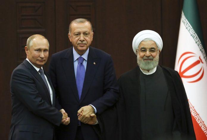 Turkish President Recep Tayyip Erdogan (C), Russian President Vladimir Putin (L) and Iranian President Hassan Rouhani pose for a group photo after their summit in Ankara, Turkey, on Sept. 16, 2019. (Photo by Mustafa Kaya/Xinhua)