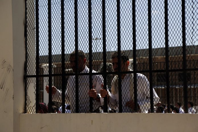Prisoners are seen before being released at a prison in Sanaa, Yemen, on Sept. 30, 2019. Yemen's Houthi group released on Monday 290 prisoners, the International Committee of the Red Cross (ICRC) said in a statement. (Photo by Mohammed Mohammed/Xinhua)