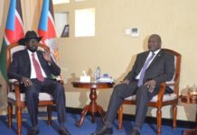 South Sudanese President Salva Kiir (L) converses with opposition leader Riek Machar in Juba, capital of South Sudan, Jan. 15, 2020. South Sudan warring parties on Wednesday agreed to continue with further consultations on the contentious issue of the number of states after Salva Kiir and Riek Machar met in Juba. (Xinhua/Denis Elamu)