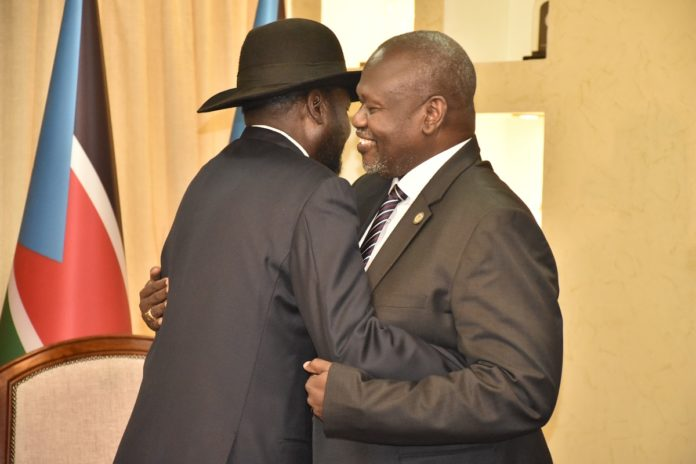 South Sudan's President Salva Kiir (L) welcomes opposition leader Riek Machar at State House in Juba, capital of South Sudan, Jan. 15, 2020. South Sudan warring parties on Wednesday agreed to continue with further consultations on the contentious issue of the number of states after Salva Kiir and Riek Machar met in Juba. (Xinhua/Daniel Majak)