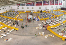 """Aerial panoramic photo taken on Feb. 4, 2020 shows the interior of a cultural building complex dubbed """"Wuhan Livingroom"""", which is being converted into a hospital to receive patients infected with the novel coronavirus, in Wuhan, central China's Hubei Province. Wuhan plans to convert three existing venues, including a gymnasium and an exhibition center, into hospitals to receive patients infected with the novel coronavirus (2019-nCoV), the headquarters for the epidemic control said late Monday. (Xinhua/Cai Yang)"""
