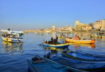 Palestinian fishermen go fishing on their boat at a seaport in Gaza, Feb. 5, 2020. The Israeli army decided on Wednesday to reduce the allowed fishing zone off the Gaza Strip coast from 15 to 10 nautical miles, said Israeli and Palestinian sources. (Photo by Rizek Abdeljawad/Xinhua)