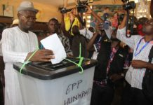 Former Prime Minister and ex-president of the National Assembly Agbeyome Messan Kodjo (L) casts his ballot at a polling station in Lome, Togo, on Feb. 22, 2020. Togo's presidential election kicked off on Saturday at 7 a.m. local time (0700 GMT). Seven candidates, including the incumbent president Faure Gnassingbe, who has been in power since 2005 and is looking for a fourth term, compete for presidency. (Xinhua/Xiao Jiuyang)
