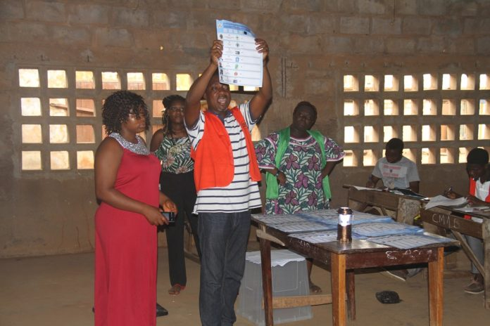 A staff member of Togo's Independent National Electoral Commission shows a ballot at a polling station in Lome, Togo, on Feb. 22, 2020. Togo's presidential election kicked off on Saturday at 7 a.m. local time (0700 GMT). Seven candidates, including the incumbent president Faure Gnassingbe, who has been in power since 2005 and is looking for a fourth term, compete for presidency. (Xinhua/Xiao Jiuyang)