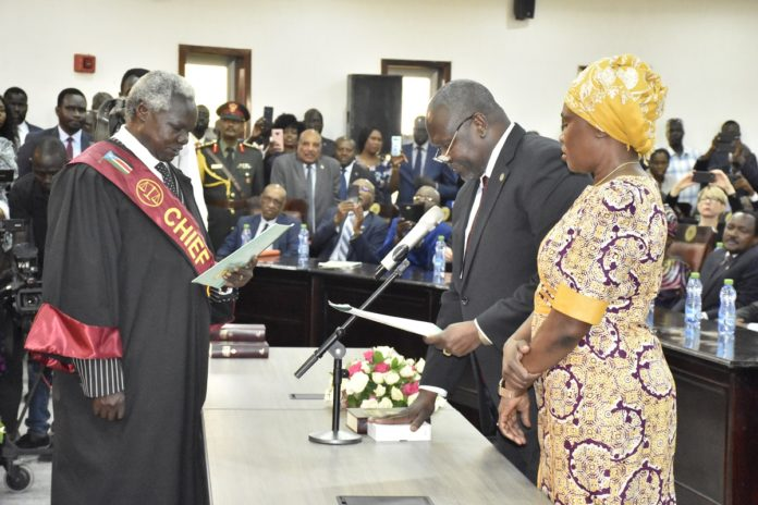 Riek Machar (2nd R, front) takes oath as the first vice president of the new transitional unity government in Juba, capital of South Sudan, Feb. 22, 2020. South Sudan formed a transitional unity government on Saturday after the youngest country in Africa had been ravaged by years of civil war. Machar was sworn in along with three other new vice presidents -- Taban Deng Gai, James Wani Igga and Rebecca Nyandeng De Mabior, at a ceremony attended by some regional leaders in Juba. (Photo by Daniel Majack/Xinhua)
