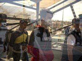 Pedestrians wearing masks are seen in downtown Tehran, Iran, Feb. 23, 2020. Iranian President Hassan Rouhani on Sunday issued an order to form a national headquarters to cope with the outbreak of the novel coronavirus in the country, state TV reported. Since Iran announced the first batch cases of the coronavirus in the country on Wednesday, 43 Iranians have been confirmed infected by the virus, eight of whom have died. (Photo by Ahmad Halabisaz/Xinhua)