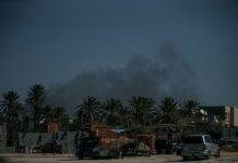 Smoke rises from Mitiga International Airport in Tripoli, Libya, Feb. 28, 2020. The forces of the UN-backed Libyan government said on Friday that the rival east-based army attacked the Mitiga International Airport in Tripoli with heavy shelling. (Photo by Amru Salahuddien/Xinhua)