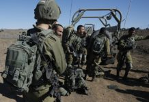 "Israeli soldiers gather on November 20, 2019 near the settlement Merom Golan in the Israeli-annexed Golan Heights, seized from Syrian in the 1967 Arab-Israeli war. - The Israeli army carried out a ""wide-scale"" attack against Iranian forces and Syrian army targets in Syria early on November 20, killing at least 11 fighters, the Israeli army and a monitoring group said. In a rare confirmation of their operations in Syria, the Israeli army said they carried out dozens on strikes against the Iranian elite Quds Force and the Syrian military, in response to four rockets fired at Israel a day before. (Photo by JALAA MAREY / AFP)"