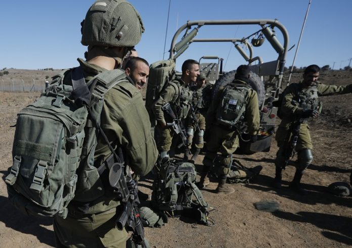 Israeli soldiers gather on November 20, 2019 near the settlement Merom Golan in the Israeli-annexed Golan Heights, seized from Syrian in the 1967 Arab-Israeli war. - The Israeli army carried out a